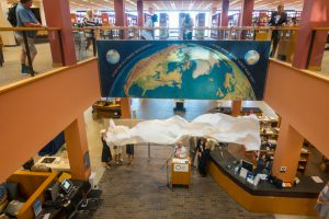 Kingman NYT mural dedicated at the Dale Clark Library, Maureen Waldron, and the Kingman daughters present.